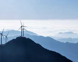 wind turbines and the sea of clouds on stretches of blue mountains background,a panoramic view of the beautiful natural scenery